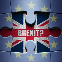 Missing piece from a European jigsaw puzzle revealing British flag and Brexit question