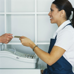 Cashier Handing Credit Card to Customer ca. 2002