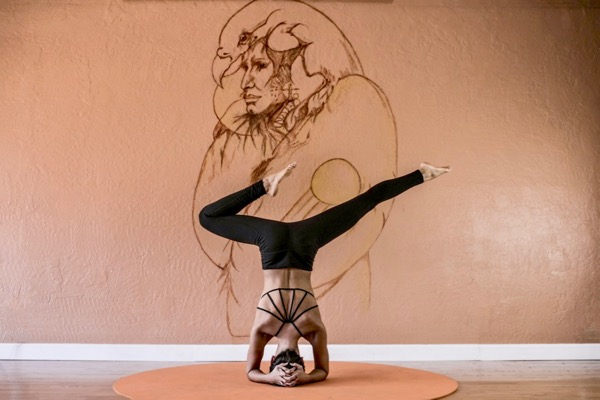 Headstand woman in the Best Yoga Pants